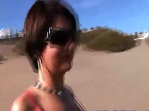 Sexy MILF topless on the beach